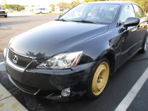 Lexus with wheel and front end damage