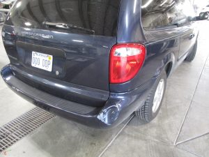 dent on back bumper of a Grand Caravan