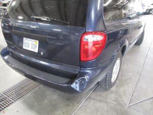 dent on back bumper of a Grand Caravan