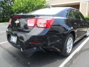 vehicle with damage to back end and fender