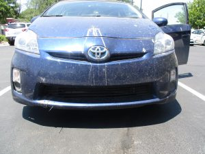front of vehicle damaged and dirty