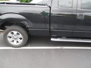 damage on side of a truck