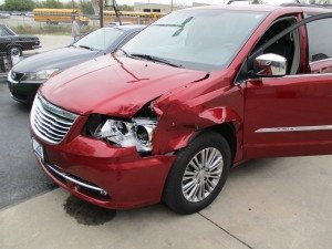 red suv damaged in car accident