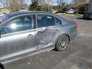 damaged door on jetta car
