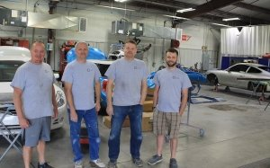 Four of the skilled auto technicians at Collision Center of Andover