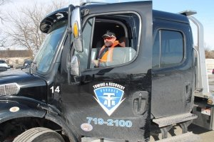 Tow truck driver in Collision Center of Andover's towing service truck – serving Wichita area