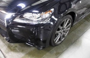Small vehicle damage to the front of a 2015 Lexus.