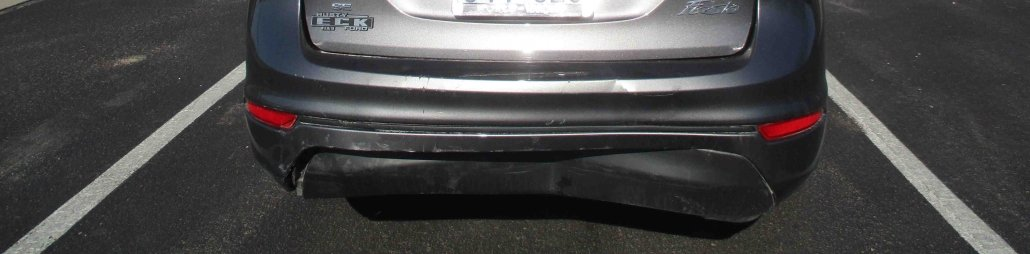 Bumper dented on the back of a 2014 Ford Fiesta, repaired at Collision Center of Andover