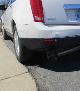 Fender bender damage done to the back of a 2011 white cadillac, taken in for repairs to Collision Center of Andover.