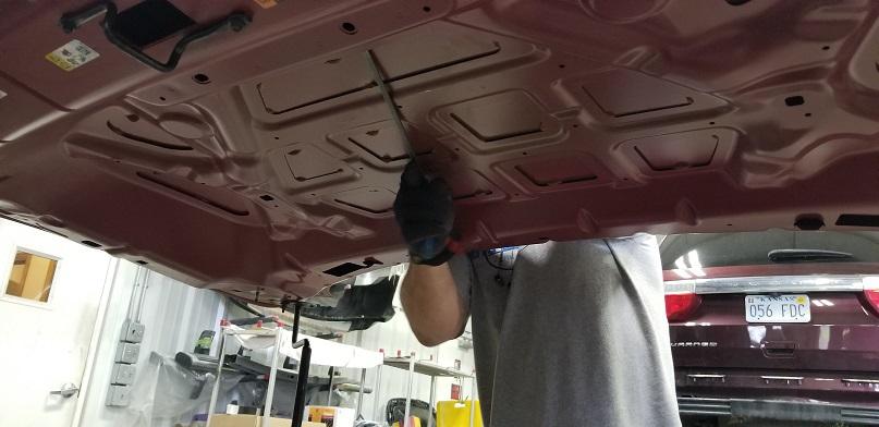 Under the hood of seeing paintless dent repair technician