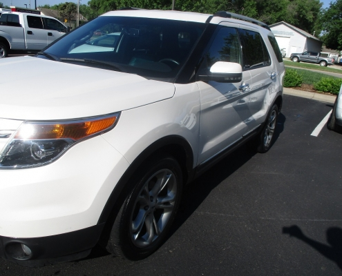 White Ford Explorer repaired with pdr door ding service from Collision Center of Andover