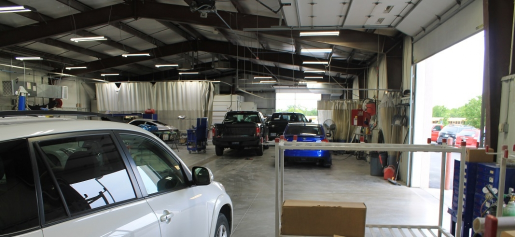 Inside look at auto body shop providing paintless dent repair service and more