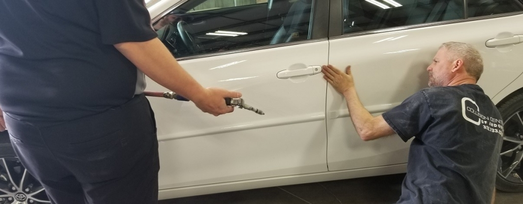 White car door damaged repaired by autobody technician at Collision Center of Andover