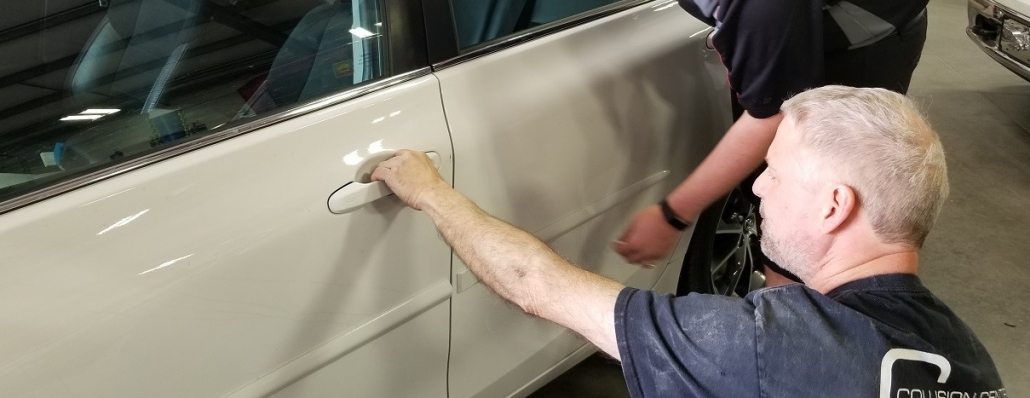 White car door damaged repaired by autobody technician at Collision Center of Andover, serving entire Wichita area